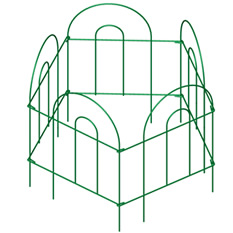 Five pieces of green garden border folding fence encircle to form a small space.