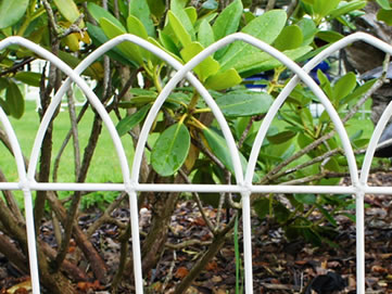 The detail about looped lawn edging garden border fence protects plants in the garden.