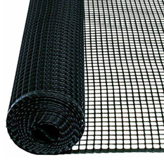 A roll of plastic mesh garden fencing with some unfolded part is lying on the ground.