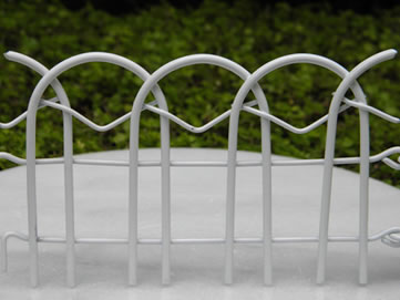 Elegant One Piece Of White Fairy Fence With Two Hooks And Holes Stands On The White  Ground. Fairy Garden Border Fence Is ...