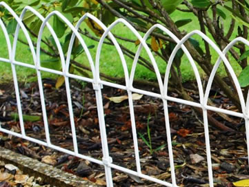 The fence decorates the garden and blends beautiful into the landscape.
